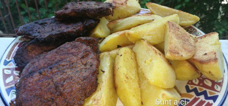 Cartofi aurii cu grătar de porc marinat
